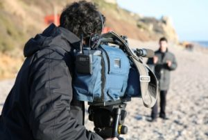 TV footage being filmed on Branscombe beach amongst the debris of the Napoli wreckage